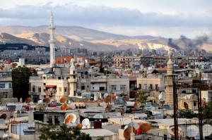 """Российский президент отметил, что в сирийской столице """"невооруженным глазом можно заметить признаки восстанавливающейся мирной жизни""""."""