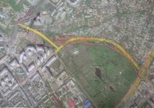 Проложив новую дорогу от Московского шоссе в обход Ботанического сада.