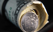 Курс долларав ходе торгов на Московской бирже опустился до 71 рубля