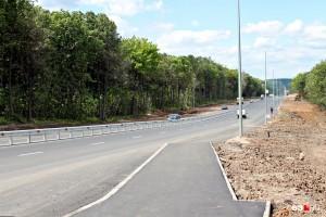 Ремонт Красноглинского шоссе в Самаре подходит к концу Подрядчик уже установил отбойник и обустроил тротуары вдоль дороги